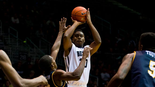 Butler's Kelan Martin (30) puts up a shot during the first  half of the Bulldogs' 70-48 win over Chattanooga on Nov. 15, 2014.