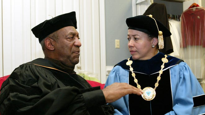 In this May 14, 2006 file photo, Bill Cosby talks to Spelman College President Dr. Beverly Tatum.