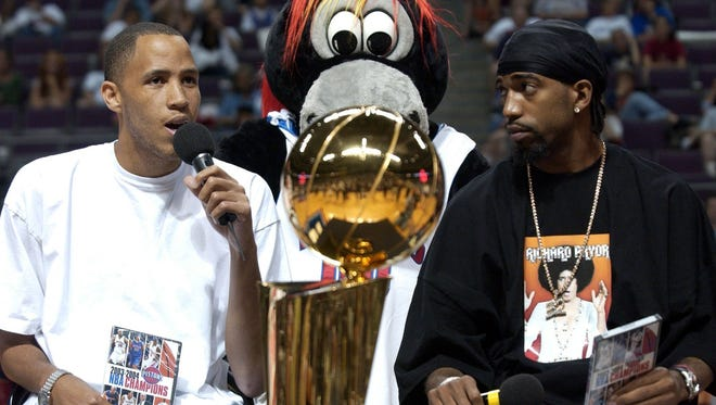 Pistons forward Tayshaun Prince, left, and guard Richard Hamilton, right, answer questions at center court with the NBA championship trophy on July 12, 2004 in Auburn Hills.