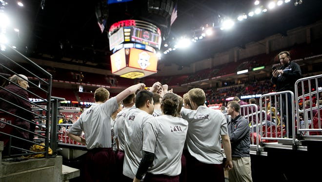 Green Bay N.E.W. Lutheran High School huddles up before their game against Hillsboro High School during the Division 5 semifinal basketball game in the 100th annual WIAA State Boys Basketball Tournament at the Kohl Center on March 19, 2015, in Madison, Wis.