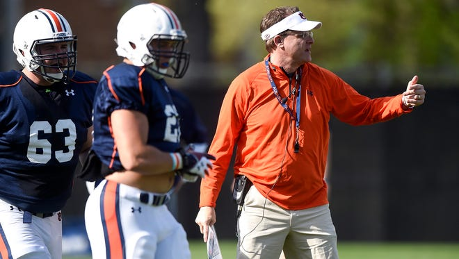 Auburn coach Gus Malzahn points something out during Tuesday's practice.