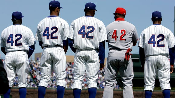 Chicago Cubs' Lester Strode, from left,  Derrek Lee, Cliff Floyd, Cincinnati Reds' Ken Griffey Jr. and Cubs' Jacque Jones, line up Sunday, April 15, 2007 in Chicago, before the Cincinnati Reds and the Chicago Cubs baseball game.They wore No. 42 in honor of the 60th anniversary of Jackie Robinson's major league debut(.