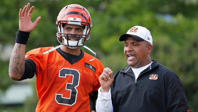 Fourth-year quarterback Terrell Pryor talks to Cincinnati Bengals offensive coordinator Hue Jackson during rookie camp, Friday on practice fields near Paul Brown Stadium in Cincinnati, Ohio.