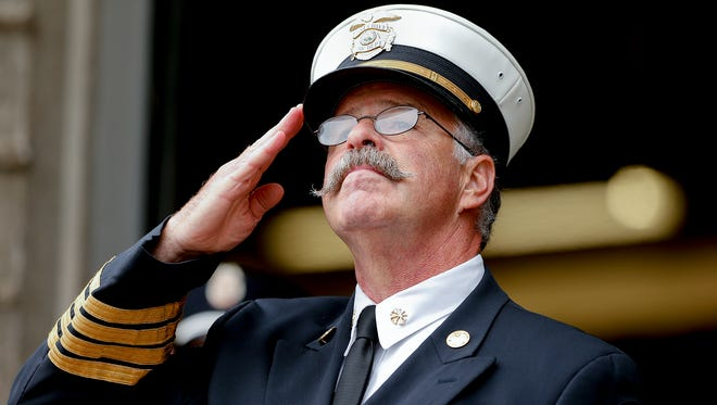 Steve Hester salutes the flag at a Sept. 11 ceremony. At the time, Hester was Asst. Fire Chief. He was appointed Fire Chief in 2015. Earlier this month, he notified the city he is retiring in May.
