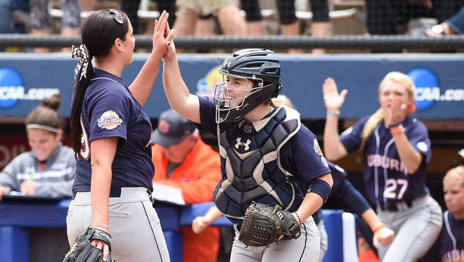 Auburn's Rachael Walters (19) and Carlee Wallace celebrate the game-winning strikeout against Tennessee in the Women's College World Series on Saturday.