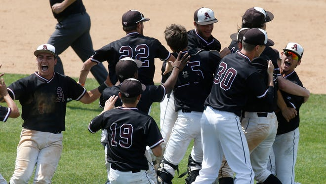 Appoquinimink players celebrate Saturday after their 10-2 win over Cape Henlopen to give the Jaguars the school's first state title in any sport at Frawley Stadium.