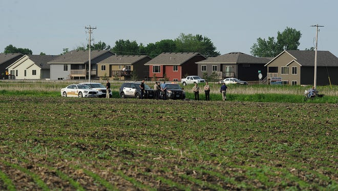 Authorities respond to a field after a man's body was found in southwestern Sioux Falls. The Sheriff's Office said that foul play was no suspected.
