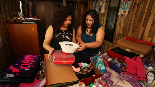 Aylin Villalba, 15, left, and her aunt, Maria Medina, both of Marshfield, prepare prizes, at Villalba's home, Friday, June 19, 2015, for their fundraising event today at Wildwood Park in Marshfield.