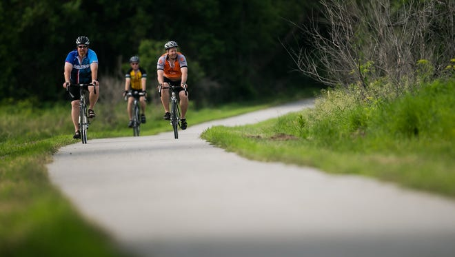 Riders head north on the Raccoon River Trail out of Panora, June 20, 2015.
