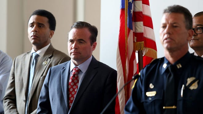 Police Captain Michael Neville (right) would not tell The Enquirer what staffing levels are for ensuring proper neighborhood police coverage during All-Star festivities. From left in this file photo are Cincinnati City Councilman Christopher Smitherman and Mayor John Cranley.