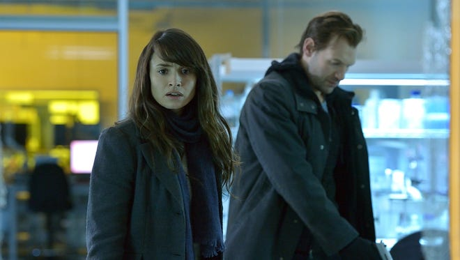 Mia Maestro as Nora Martinez and Corey Stoll as Ephraim Goodweather are in the Season 2 premiere of  'The Strain.'