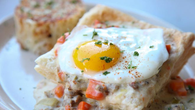 Flaky puff pastry smothered in homemade rosemary sausage gravy and topped with an egg is Snooze's version of breakfast pot pie.