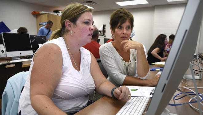 Teachers Belinda Walsh and Mona Torborg from Cold Spring Elementary learn about a program called Kid Blog to use in their classrooms. The lesson was part of a technology summit Thursday at Rocori High School in Cold Spring.