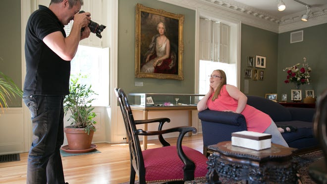 Rick Guidotti photographs Ellen Beisheim in the East Gallery at the George Eastman House in Rochester on Aug. 17, 2015.