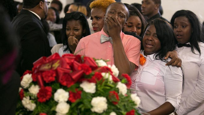 Visitors say their final goodbyes at the funeral for Jonah Barley in Rochester on Saturday, Aug. 29, 2015. Barley was killed in a drive-by shooting on Genesee Street on Aug. 19.