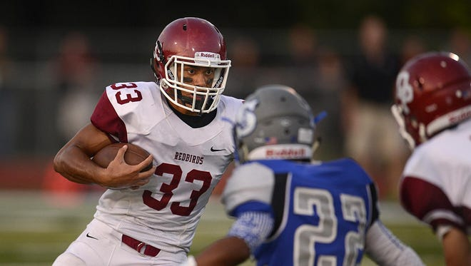 De Pere running back Nik Ohuafi (33) looks for room to run during Friday's game at Green Bay Southwest. Ohuafi leads the FRCC with 485 rushing yards.