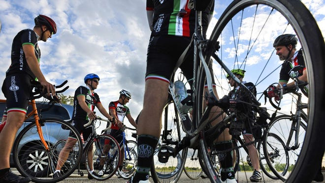 Riders of the House of Pizza Fitness Team gathered in Sartell in September to remember two members of the cycling, duathlon and triathlon communities who died recently. John Seiler and Todd Steinke were remembered by the team on their weekly ride.