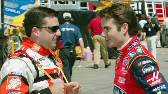 FILE -- Tony Stewart, left, talks with Jeff Gordon, right, in the garage area May 23, 2002 during practice for NASCAR's Coca-Cola 600.