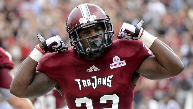 Troy running back Brandon Burks celebrates his first-quarter touchdown against UAB on Saturday. AP Troy running back Brandon Burks celebrates his first-quarter touchdown against UAB during a NCAA college football game at Veterans Memorial Stadium in Troy, Ala. Saturday, Aug. 31, 2013. (AP Photo/ AL.com, Mark Almond)
