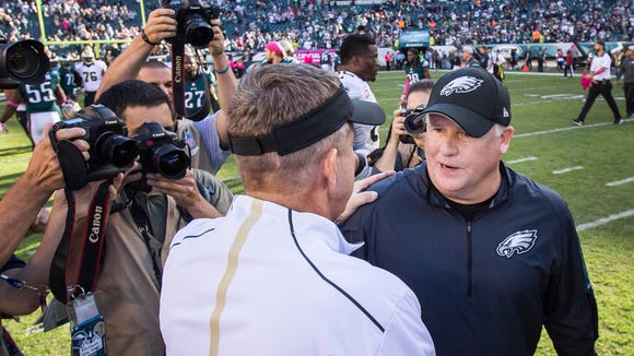 Philadelphia Eagles head coach Chip Kelly (right) shakes hands with New Orleans Saints Head Coach Sean Payton following the Eagles 39-17 win over the Saints at Lincoln Financial Field in Philadelphia, Pa. on Sunday afternoon.