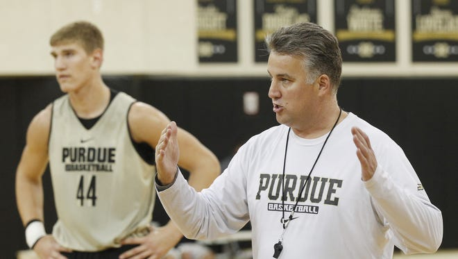 Matt Painter with instructions for his players before the start of a drill during men's basketball practice, Oct. 5, 2015, at Cardinal Court.