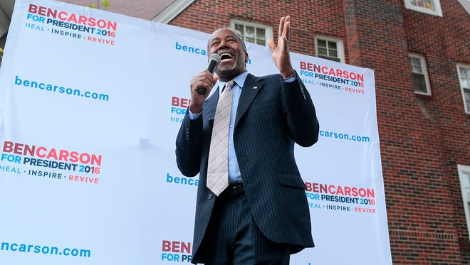 Republican presidential candidate Ben Carson talks to supporters during a campaign stop at the Alpha Gamma Rho fraternity on October 24, 2015 in Ames, IA.