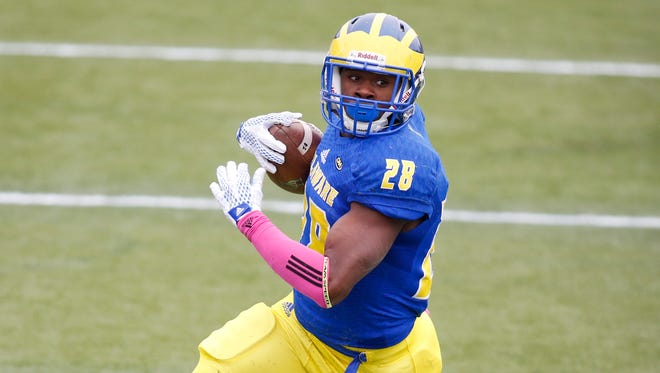 Delaware running back Thomas Jefferson tries to go wide in the first quarter at Delaware Stadium Saturday.