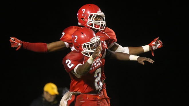 Oakland's JaCoby Stevens (7) and Mark Pruitt (2) celebrate Steven's touchdown against William Blountduring  the first game of the playoffs, at Oakland, on Friday Nov. 6, 2015.