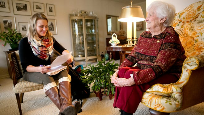 University of Wisconsin - Stevens Point student Brittany Falk, left, talks to Jean Hamm for a multi-generational writing project at Hamm's home in Stevens Point on Nov. 12, 2015. The writing project is connecting students with senior citizens to write about their life stories.