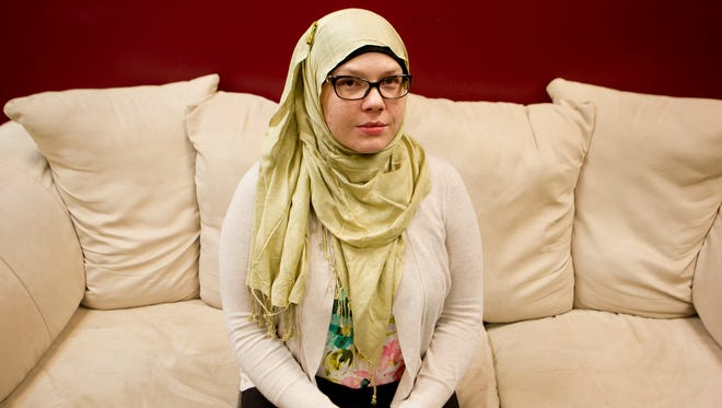 Katherine Graebel-Khandakani of Weston poses at the University of Wisconsin-Stevens Point, Monday, Nov. 30, 2015. Graebel-Khandakani's husband and his family are Syrian, including some who have fled that country's civil war as refugees. Her husband's parents are seeking asylum in the United States.