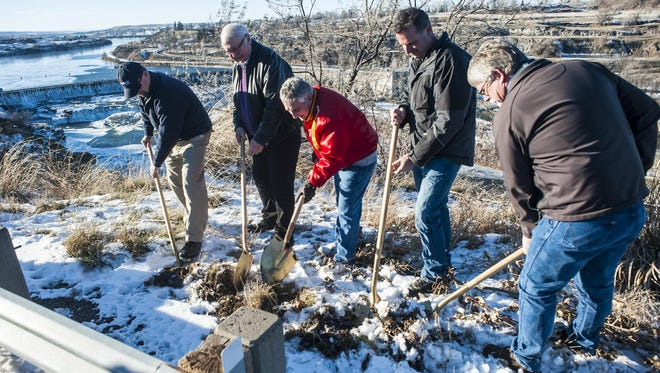 Left to Right, Bob Vinson, Art Dickhoff, Mike Winters, Joe Horner and Dave Hand break ground Tuesday at the Black Eagle pullout, symbolizing the start of construction that will transform the area into an overlook.