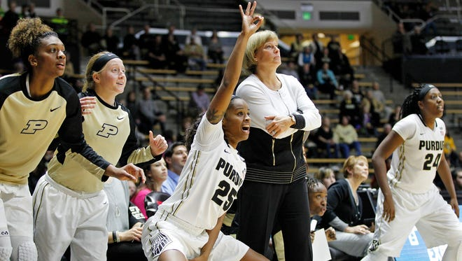 April Wilson, center, and her teammates celebrate a Purdue three-point basket against Incarnate Word Thursday, December 10, 2015, at Mackey Arena. Purdue dismantled Incarnate Word 95-27.