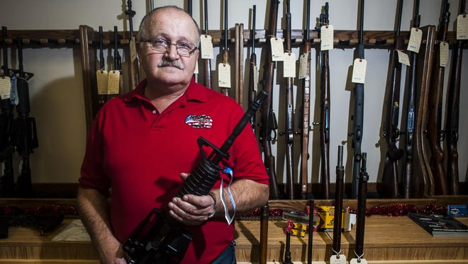 """Jim Mitchell, who holds a Colt M4 .22 in his shop Mitchell Supply on Wednesday, said ammunition isn't as in short supply as it was a few years ago, but it still can be tough to find for some calibers. """"Anytime there is talk about guns, people think they have to go and buy the gun and then they get the ammunition to go with it,"""" he said."""
