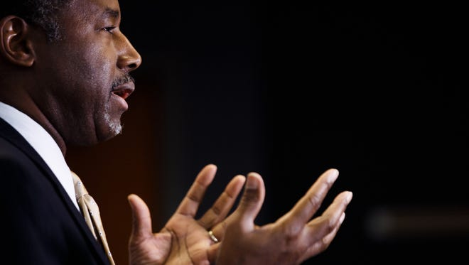 Ben Carson talks to the media in Des Moines on Jan. 25