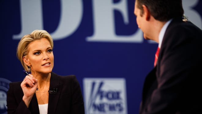 Moderator Megyn Kelly interviews republican presidential candidate Ted Cruz in the spin room after the republican debate at the Iowa Events Center on Thursday, Jan. 28, 2016, in Des Moines.