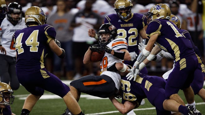Sergeant Bluff-Luton's Matt George is tackled during their semifinal game at the UNI-Dome in November.
