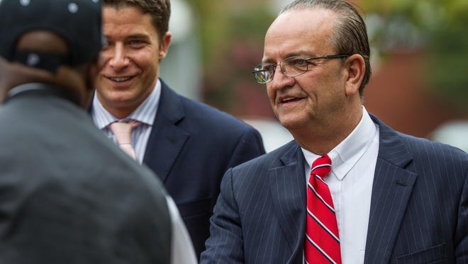 At a 2012 event in Wilmington are David Grimaldi, then chief administrative officer of New Castle County, (left) and County Executive Thomas P. Gordon. Grimaldi has filed a wrongful termination lawsuit against Gordon, his former mentor.