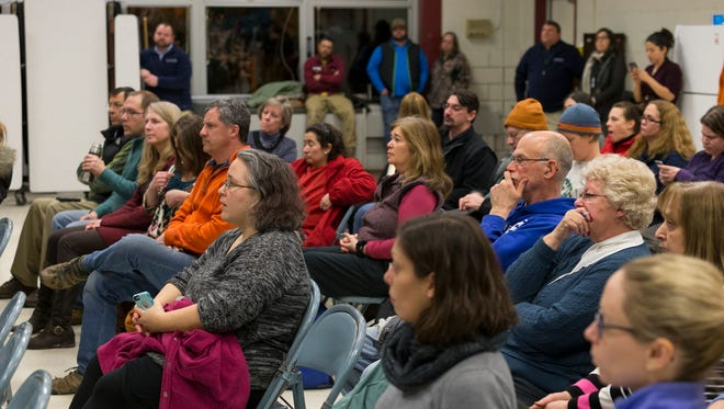 Caroline Elementary School parents listen to officials from the Ithaca City School District and other agencies on February 10 as they discuss the results of tests for lead in the school's water.