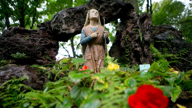 A statue of St. Bernadette sits on display at the Rudolph Grotto Gardens, Monday, Aug. 17, 2015.