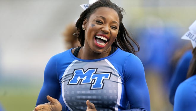 MTSU cheerleader Marresa Burke runs back to the sidelines from the field from the MTSU football game against North Texas on Saturday, Nov. 21, 2015.