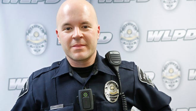 Officer Don Greenwood displays the VIEVU body cam worn by members of the West Lafayette Police department Wednesday, March 9, 2016, at WLPD headquarters.