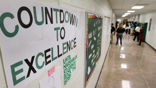 """""""Countdown to Excellence"""" signs and other ISTEP reminders appear on middle school bulletin boards."""