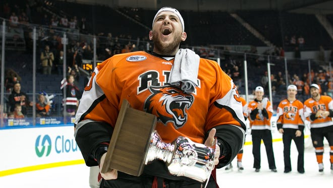 RIT goaltender Mike Rotolo, a Greece native, celebrates after RIT defeated Robert Morris.