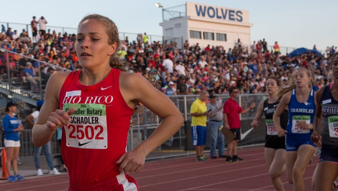 Allie Schadler (left) from Rio Rico High School leads the mile run at the 76th Chandler Rotary Track Meet at Chandler High School on Saturday, Mar. 19, 2016 in Chandler, Ariz.