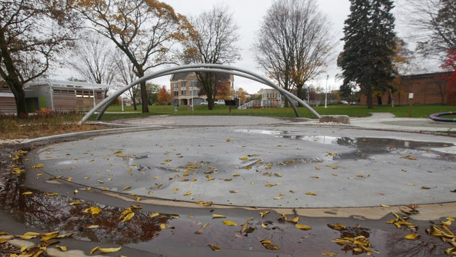 Leaves are strewn about the William G. Milliken Waterscape splash pad at Clinch Park in Traverse City in November 2015.