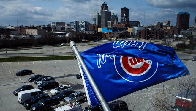 An Iowa Cubs flag flies over the parking lot during an open workout at Principal Park on Wednesday, April 06, 2016, in Des Moines.