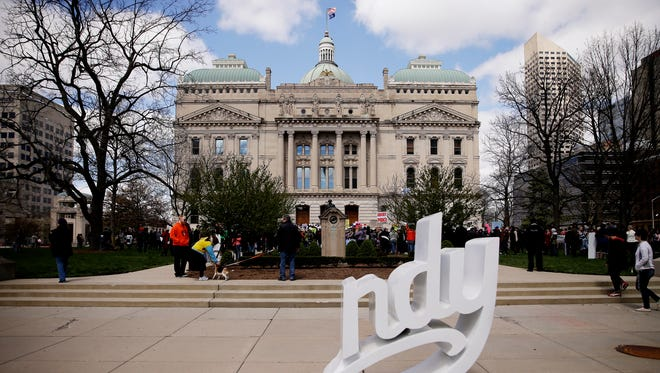 Thousands rally for women's rights in front of the Indiana State House on April 9, 2016. The rally, in response to a controversial new Indiana abortion bill, is designed to bring together women and the men who support them who all believe that women should have the right to decide what to do with their bodies without government intrusion. The abortion bill, signed into law by Gov. Mike Pence on March 25, requires the remains of aborted or miscarried fetuses to be interred or cremated. It also bans abortions sought solely due to fetal abnormality, including Downs syndrome, as well as sought solely on the basis of race or gender. It will go into effect July 1.
