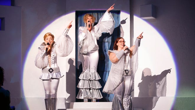 """Laura Michelle Hughes (Tanya), Erin Fish (Donna), and Sarah Smith (Rosie) in the 2015 North American tour of """"Mamma Mia!"""""""