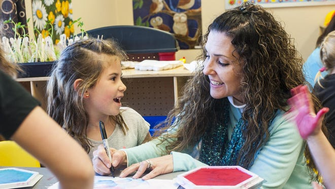 Deb Huestis helps Isabella Boyer, 5, with an art project related to the book Beautiful Hands in the Learning Center on Monday. Ready Family Ready Learners has organized a Play Fair with activities for preschoolers as well as tools and tips for parents to help prepare their children for school.