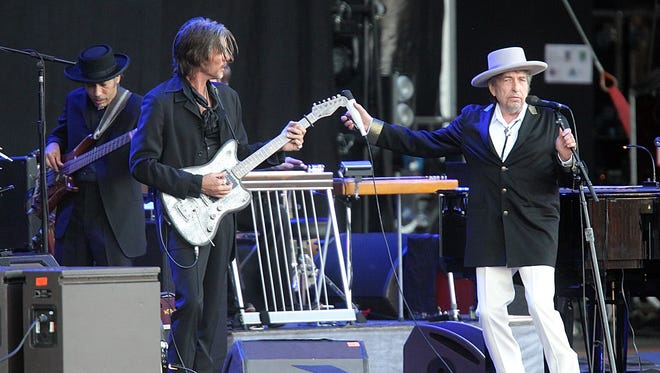 """Bob Dylan performs on stage on July 22, 2012, at """"Les Vieilles Charrues"""" Festival in Carhaix, western France."""